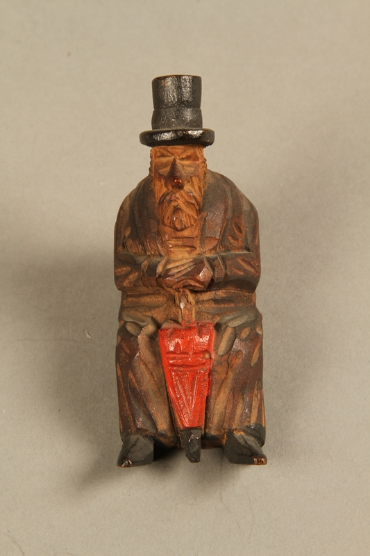 2016.184.110_d  front Tobacco pipe with decorative wooden stand of three Jews on a bench
