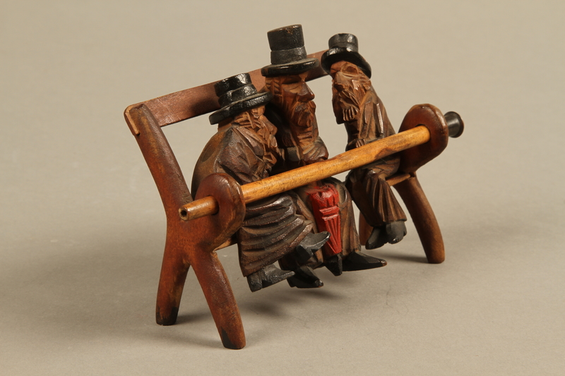 2016.184.110_a-e right side Tobacco pipe with decorative wooden stand of three Jews on a bench