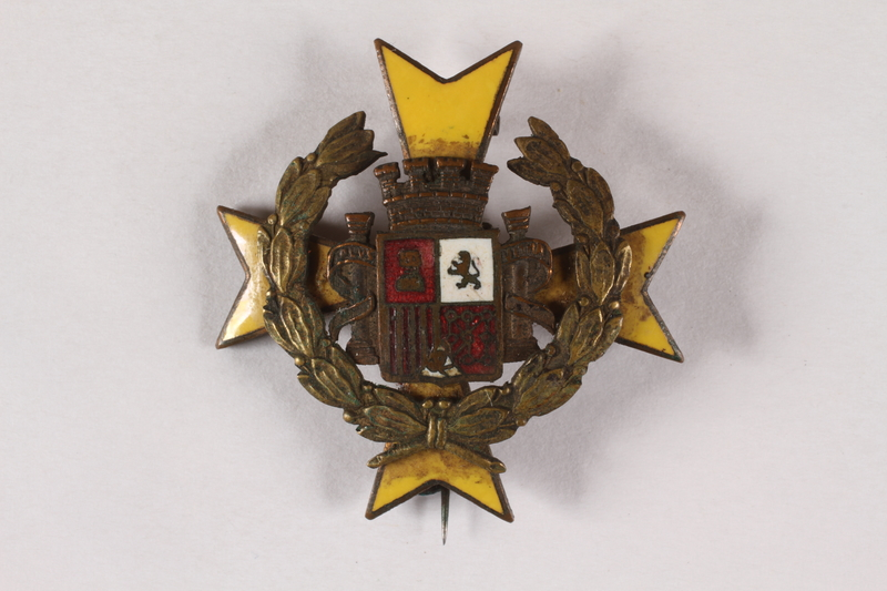 2004.295.2 front Pin with the Spanish coat of arms owned by an International Brigade member