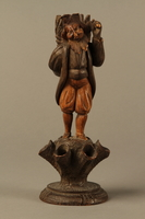 2016.184.111 front Carved cigarette and match holder of a Jewish peddler carrying a large sack  Click to enlarge