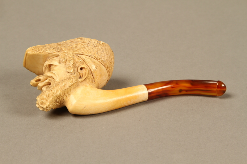 2016.184.116_a left Meerschaum pipe with the bowl carved as a Jewish man's head, with case