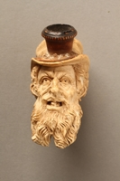 2016.184.118 front Ivory cigarette holder carved as the head of a bearded Jew  Click to enlarge