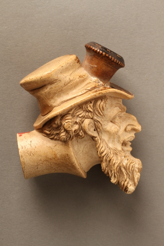 2016.184.118 right side Ivory cigarette holder carved as the head of a bearded Jew