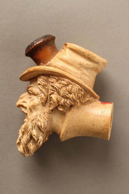 2016.184.118 left side Ivory cigarette holder carved as the head of a bearded Jew