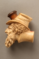 2016.184.118 left side Ivory cigarette holder carved as the head of a bearded Jew  Click to enlarge