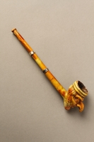 2016.184.120 right side Painted porcelain cigarette holder molded as the head of a Jew  Click to enlarge