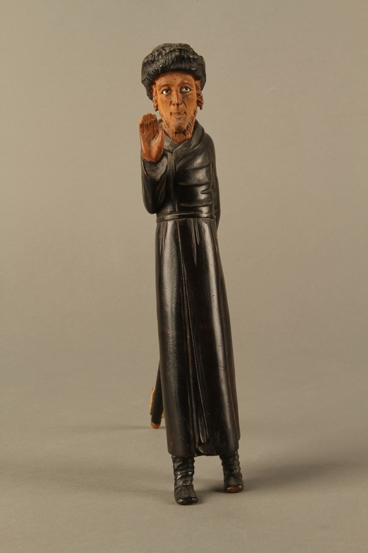 2016.184.127 front Carved wooden figure of a standing Jew enclosing a scribe's set