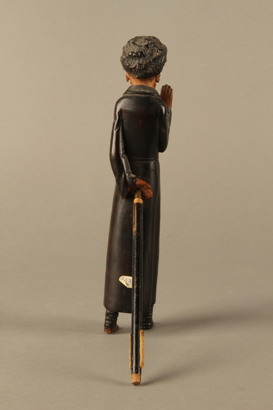 2016.184.127 back Carved wooden figure of a standing Jew enclosing a scribe's set