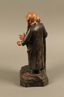 2016.184.129 left side Ceramic figure group of a poor Jew with an unhappy merchant  Click to enlarge