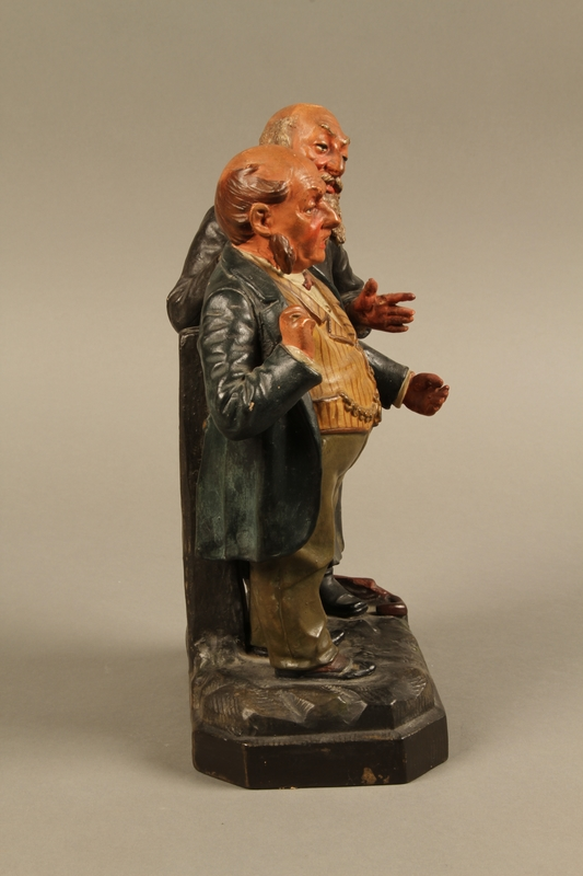 2016.184.129 right side Ceramic figure group of a poor Jew with an unhappy merchant