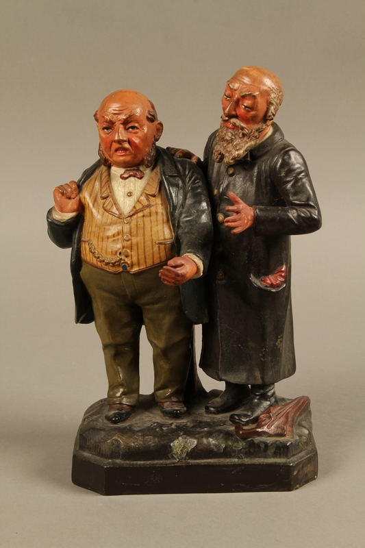 2016.184.129 front Ceramic figure group of a poor Jew with an unhappy merchant