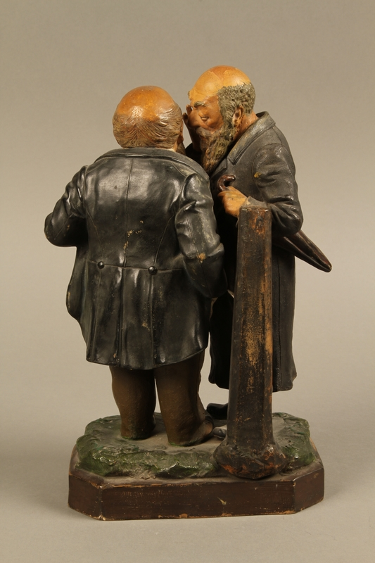 2016.184.128 back Painted figure group of a poor Jew whispering to a wealthy merchant