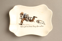 2016.184.130 front Porcelain dish with a scene of a Jewish beggar being chased by a dog  Click to enlarge