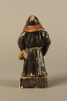 2016.184.133 back Ceramic match holder of a Jew holding out a bag  Click to enlarge