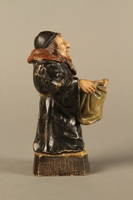 2016.184.133 right side Ceramic match holder of a Jew holding out a bag  Click to enlarge