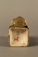 2016.184.133 bottom Ceramic match holder of a Jew holding out a bag  Click to enlarge