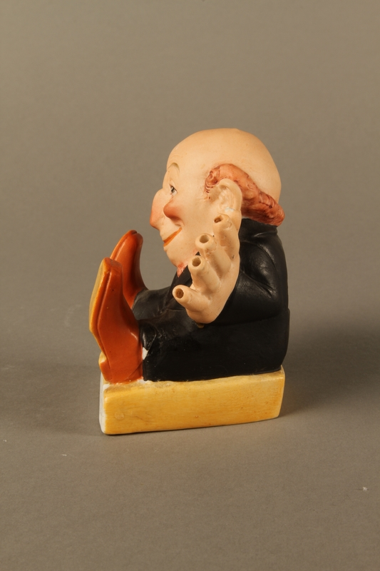 2016.184.135 left side Painted bisque toothpick holder of a Jewish man