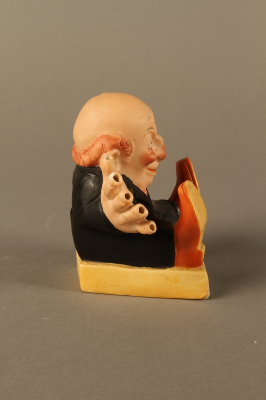 2016.184.135 right side Painted bisque toothpick holder of a Jewish man