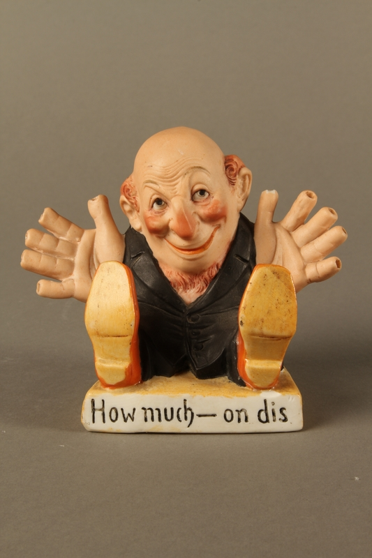 2016.184.135 front Painted bisque toothpick holder of a Jewish man