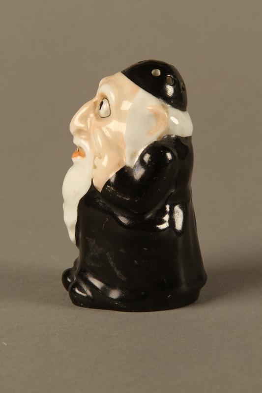 2016.184.137 left side Porcelain salt shaker of a caricatured Orthodox Jewish man