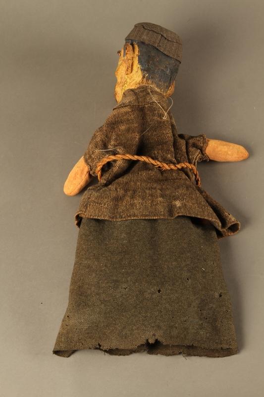 2016.184.139 back Paper mache puppet of a Jewish man in a prison uniform