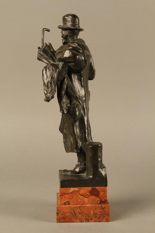 2016.184.142 left side Bronze figure of a Jewish peddler by Anton Mashik
