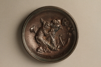 2016.184.145 front Small circular dish with a relief of two Jewish men fighting  Click to enlarge