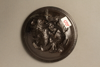 2016.184.145 back Small circular dish with a relief of two Jewish men fighting  Click to enlarge