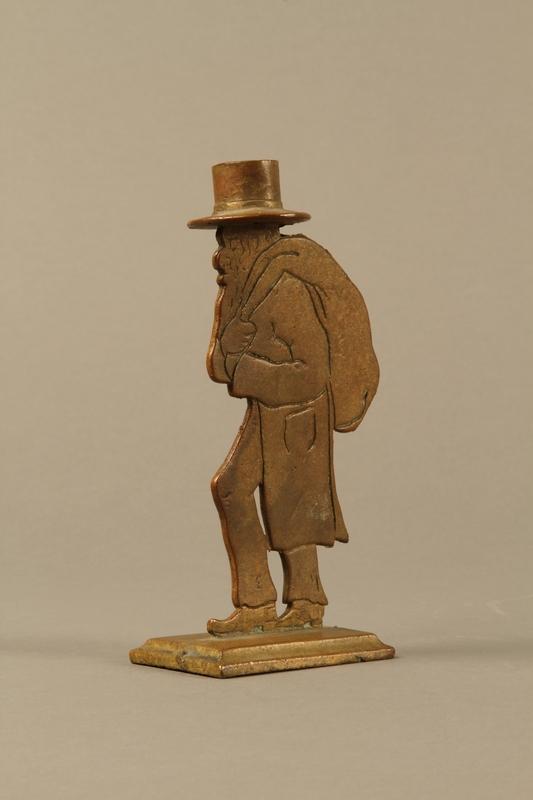 2016.184.144 3/4 view Brass figure of a Jewish peddler