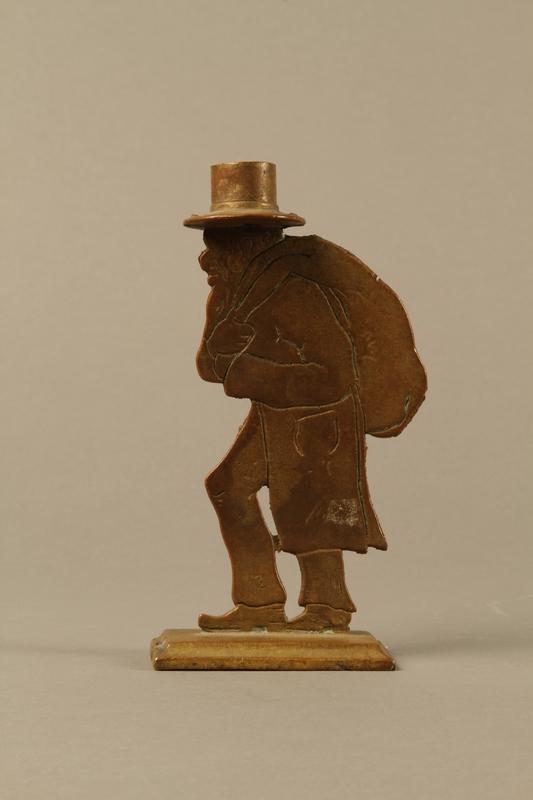 2016.184.144 left side Brass figure of a Jewish peddler