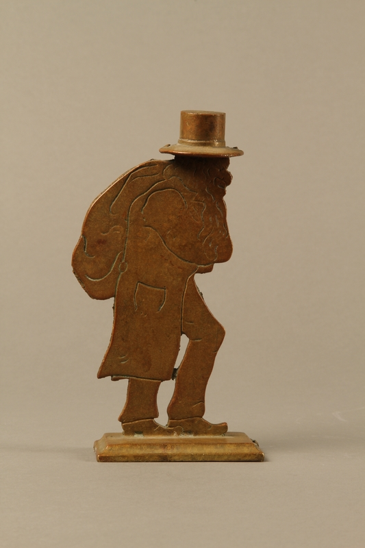 2016.184.144 right side Brass figure of a Jewish peddler