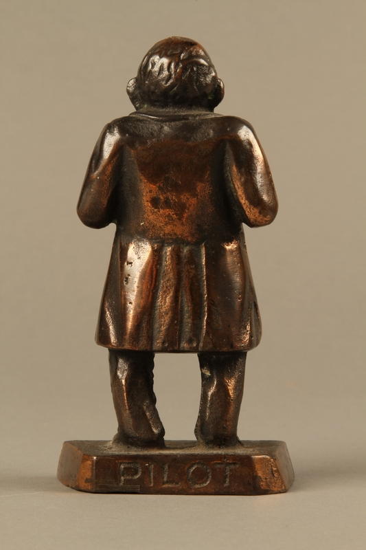 2016.184.146 back Bronze figurine mocking a pompous Jewish man with an accent