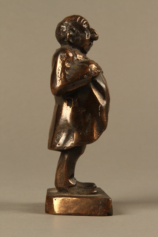 2016.184.146 right Bronze figurine mocking a pompous Jewish man with an accent