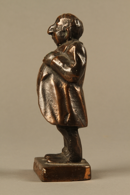 2016.184.146 left Bronze figurine mocking a pompous Jewish man with an accent