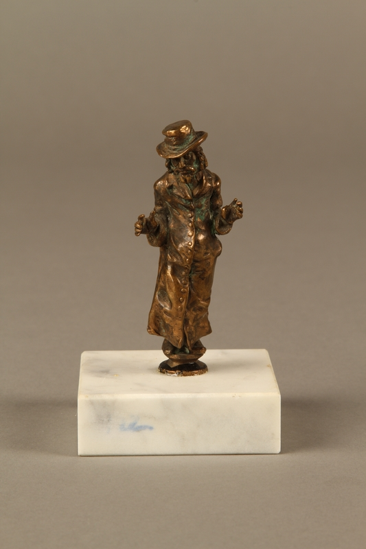 2016.184.147  front Bronze figurine of a Jewish schnorrer in his traditional long coat