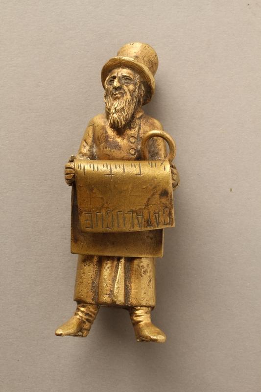 2016.184.148_a-b front Bronze figurine of a Jewish man reading a newspaper