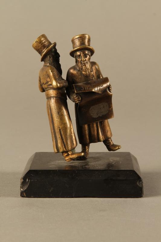 2016.184.149 front Bronze figurine of two Jewish men standing in conversation