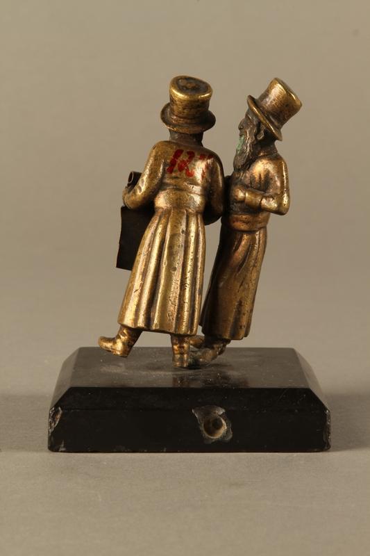 2016.184.149 back Bronze figurine of two Jewish men standing in conversation
