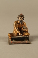 2016.184.150 front Painted bronze figurine of a Sephardic Jewish money changer  Click to enlarge