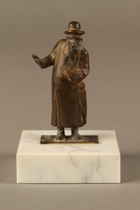 2016.184.151 front Bronze figurine of a male Jewish matchmaker with an umbrella at his side