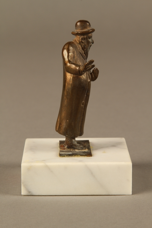 2016.184.151 right side Bronze figurine of a male Jewish matchmaker with an umbrella at his side