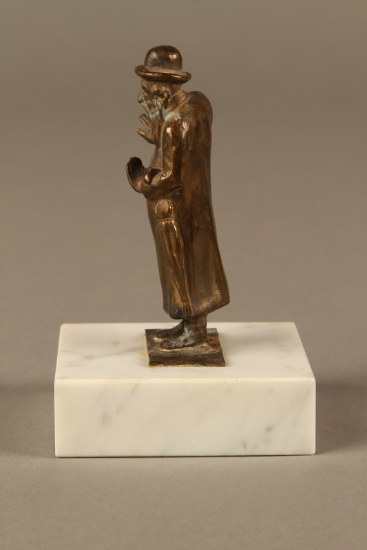 2016.184.151 left side Bronze figurine of a male Jewish matchmaker with an umbrella at his side