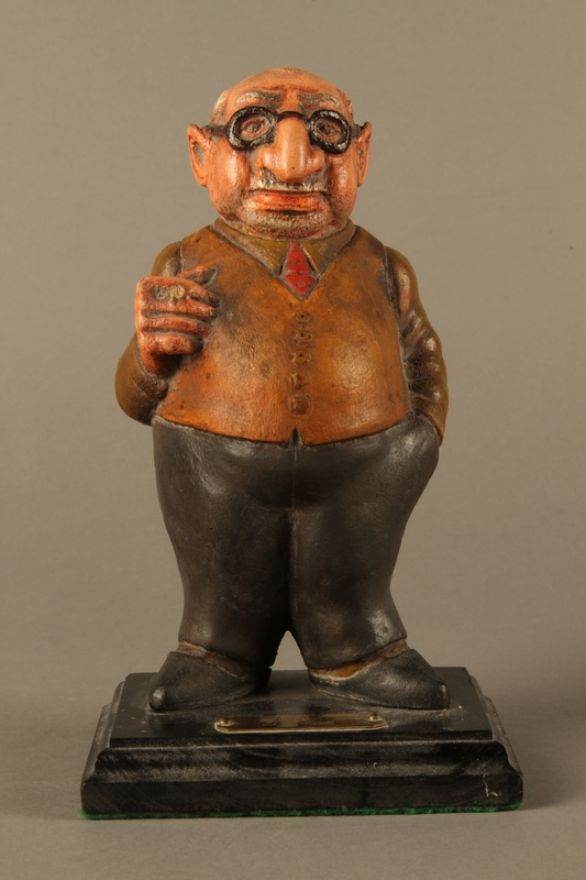2016.184.152.1 front Painted wooden figurine of a Jewish banker