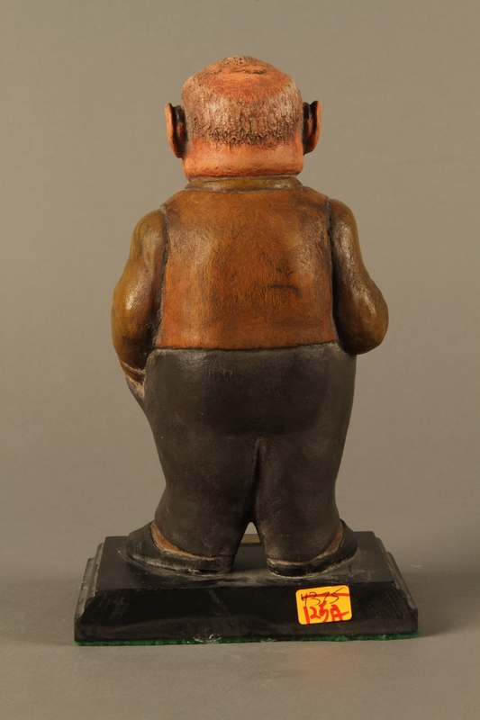 2016.184.152.1 back Painted wooden figurine of a Jewish banker