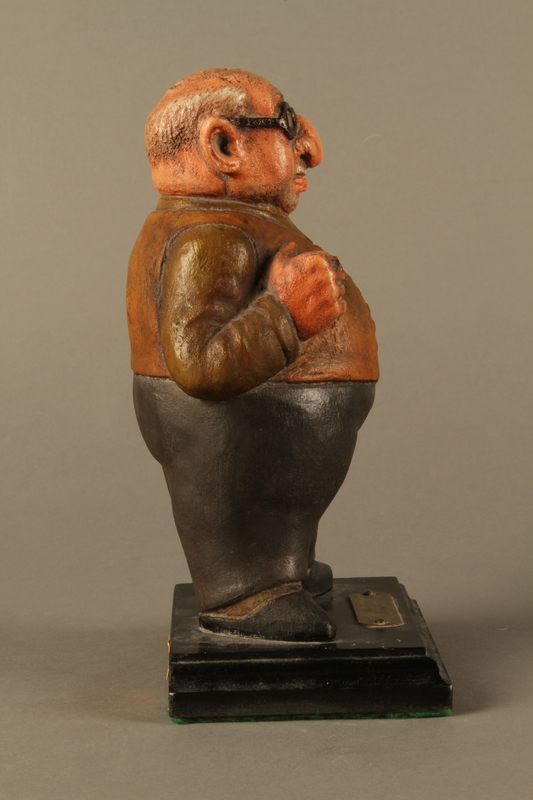2016.184.152.1 right side Painted wooden figurine of a Jewish banker