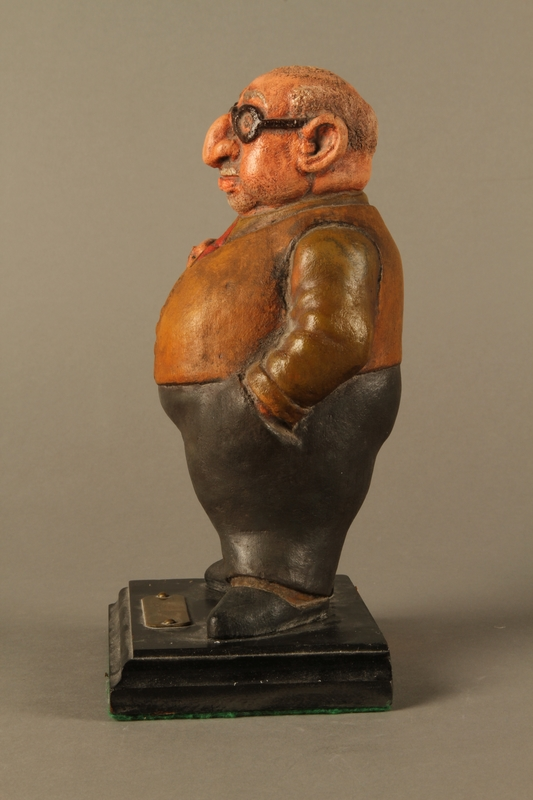 2016.184.152.1 left side Painted wooden figurine of a Jewish banker