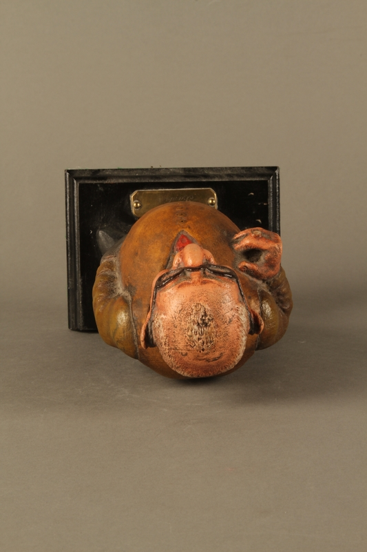 2016.184.152.1 top Painted wooden figurine of a Jewish banker