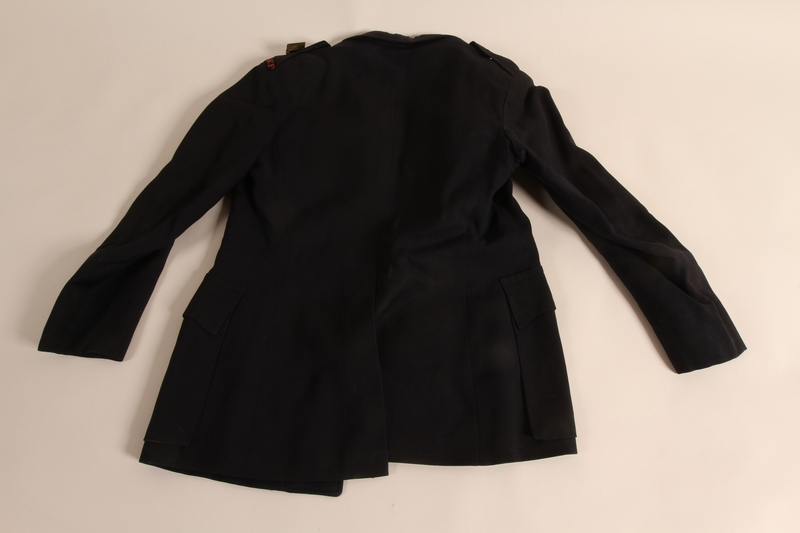 2015.539.2 back Corps Auxilliaire Voluntaire Feminin uniform jacket worn by a French woman