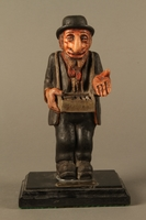 2016.184.152.2 front Painted wooden figurine of a Jewish peddler  Click to enlarge