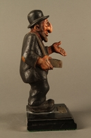 2016.184.152.2 right side Painted wooden figurine of a Jewish peddler  Click to enlarge